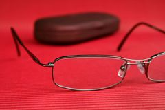 Eyeglasses and glasses case on red background Stock Photo
