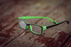 Eyeglasses glasses  on wood desk dackground Stock Image