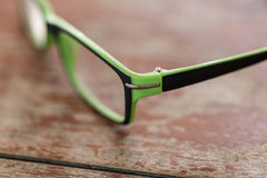 Eyeglasses glasses  on wood desk dackground Royalty Free Stock Photo