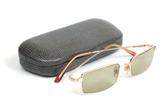 Eyeglasses and gray case Royalty Free Stock Photos