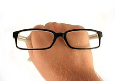 Eyeglasses on hand. Eyeglasses concept close-up on hand Stock Image