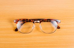 Eyeglasses isolated on wooden board Stock Image