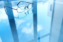 Eyeglasses and its reflection Royalty Free Stock Photos