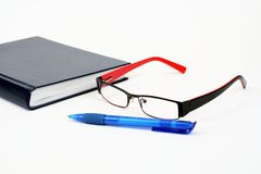 eyeglasses kalendarzowy pióro obrazy stock