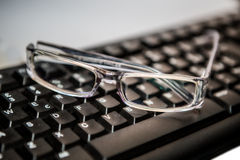 Eyeglasses with keyboard Royalty Free Stock Photography