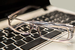 Eyeglasses with keyboard Royalty Free Stock Images