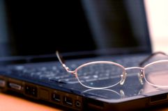 Eyeglasses on Laptop Stock Images