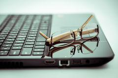 Eyeglasses on Laptop computer. Color adjust of Eyeglasses on Laptop computer Stock Images