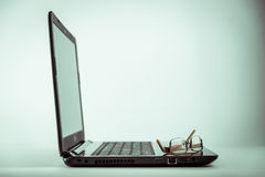 Eyeglasses on Laptop computer. Eyeglasses on Laptop computer,for thinking concepts Stock Images