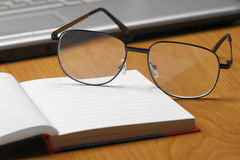 Eyeglasses,laptop and notebook. Royalty Free Stock Photo