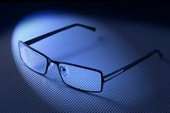 Eyeglasses Lenses Glasses. A modern pair of glasses lit by a spotlight Royalty Free Stock Photos