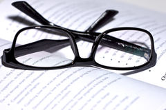 Eyeglasses lie on the book Royalty Free Stock Photography