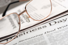 Eyeglasses lie on the newspaper Royalty Free Stock Photos
