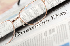 Eyeglasses lie on the newspaper Stock Image