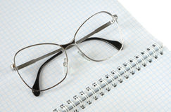 Eyeglasses lies on a notebook Royalty Free Stock Photography
