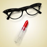 Eyeglasses and lipstick Stock Photography