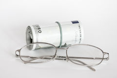 Eyeglasses and money Royalty Free Stock Photos
