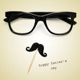 Eyeglasses and moustache, and the text happy fathers day. The sentence happy fathers day, and a pair black eyeglasses and a moustache forming a man face in a stock images