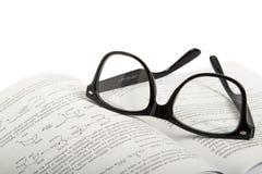 Eyeglasses na książce Obraz Stock