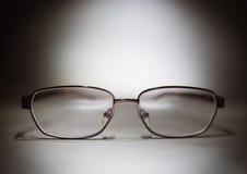 Eyeglasses na stole Obrazy Royalty Free