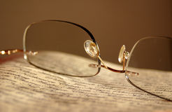 Eyeglasses on newspaper Stock Photography