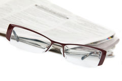 Eyeglasses and newspaper Royalty Free Stock Image