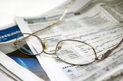 Eyeglasses on Newspaper Royalty Free Stock Photos