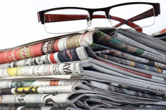 Eyeglasses and Newspapers Stock Image