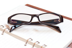 Eyeglasses on Notebook Royalty Free Stock Images