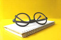 Eyeglasses on notebook Royalty Free Stock Image