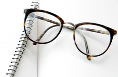 Eyeglasses and notebook close up Royalty Free Stock Image