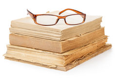 Eyeglasses on old books stock photography