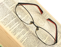 Eyeglasses on the old opren book Stock Photography