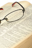 Eyeglasses on the old opren book Stock Photos
