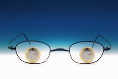 Eyeglasses with one euro coins Royalty Free Stock Image