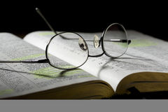 Eyeglasses on Open Bible Royalty Free Stock Photo