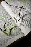 Eyeglasses on Open Bible Stock Photos