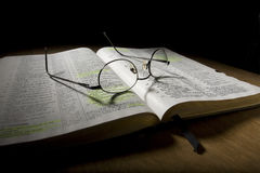 Eyeglasses on Open Bible Royalty Free Stock Photography