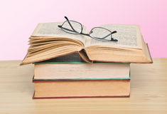 Eyeglasses on open book Royalty Free Stock Photo