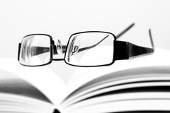 Eyeglasses on open book. In black and white Royalty Free Stock Image