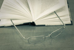 Eyeglasses on open book Royalty Free Stock Photography