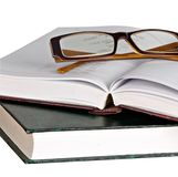 Eyeglasses on open book Stock Image