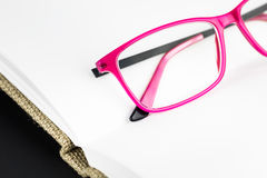 Eyeglasses on open book Royalty Free Stock Images