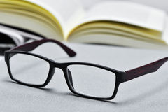 Eyeglasses and open book Stock Photo