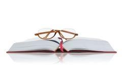 Eyeglasses on Open Book Stock Photo