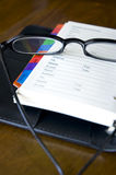 Eyeglasses on organizer Royalty Free Stock Photo