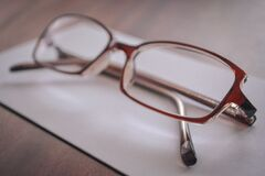 Eyeglasses on paper Royalty Free Stock Photos
