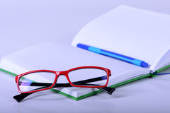 Eyeglasses and paper notebook Royalty Free Stock Photography