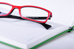 Eyeglasses and paper notebook Royalty Free Stock Photos