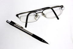 Eyeglasses and pen Royalty Free Stock Images